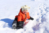 18 months baby sitting on snow — Stock Photo