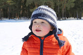 Portrait of 18 months baby against winter forest — Stock Photo