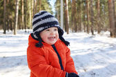 Smiling 18 months baby walking in forest — Stock Photo