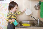 Baby washing dishes — Foto de Stock