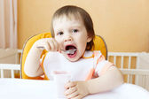 Lovely 18 months baby eating youghourt — Foto de Stock