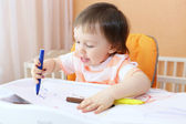 Baby with felt pens — Stockfoto