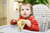 Baby eating pizza in cafe — Stock Photo
