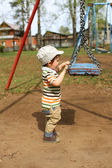 Baby and swing  — Stock Photo