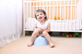 Happy baby sitting on potty — Stock Photo