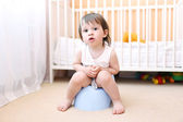 Baby sitting on potty in home — Stock Photo