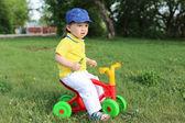 Baby boy on plastic run bike outdoors — Stock Photo