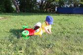 Baby falls off a bike — Stock fotografie
