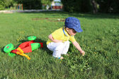 Baby age of 20 months walking in summer — Stock Photo