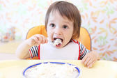 Lovely baby eating quark  — Stock Photo