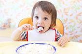 Lovely baby eating quark  — Stock Photo