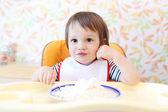 Happy baby eating quark — Stock Photo