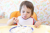Baby eating quark — Stock Photo