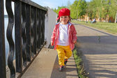 Fashionably dressed baby boy walking outdoors — Stock Photo