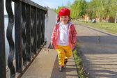 Fashionably dressed baby boy walking outdoors — Stock Photo