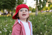 Portrait of happy baby outdoors in summer — Stock Photo