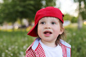 Portrait of happy baby boy in summer — Stock Photo