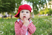 Portrait of thinking baby in summer — Stock Photo