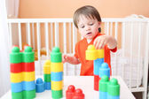 Baby playing constructor at home — Stock Photo
