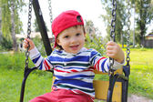 Happy baby på swing — Stockfoto