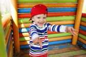 Portrait of happy baby boy on playground — Stockfoto