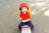 Baby on teeter-totter  — Stock Photo