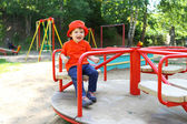 Smiling baby on merry-go-round — Stock Photo