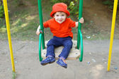 Happy baby on swing — Stock Photo