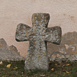 Stone cross at the cemetery wall — Stock Photo