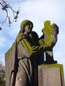 Old statue in cemetery (Vtelno, Czech Republic) — Stock Photo