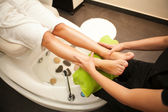 Feet massage during spa treatment. — Stock Photo