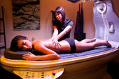 Woman giving a massage during spa treatment. — Stock Photo