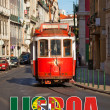 Touristic red tram in a Lisbon stree — Foto de Stock