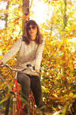Woman posing with a bike — Stock Photo