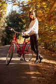 Woman posing with a bike. — Stock Photo