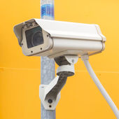 Security camera on the post with outdoor housing — Stock Photo