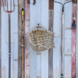 Stock Photo: Farmers tools on old wooden barn wall background