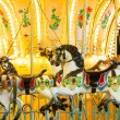 Carousel. Horses on carnival Merry Go Round — Stock Photo #37617193