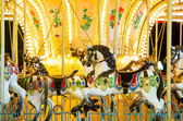 Carousel. Horses on a carnival Merry Go Round — Stock Photo