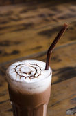 Iced chocolate on wood background — Stockfoto