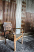 Wooden chair and zinc wall — Photo