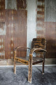 Wooden chair and zinc wall — Stock Photo