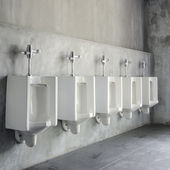 White urinals in men's bathroom — Foto Stock