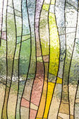Stained glass window of colored glass — Stock Photo