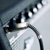 Connectors are connected in audio inputs Guitar amplifier — Stock Photo