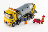 Toy car mixer and toy workers on the white background — Stock Photo