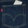 Blank paper label tag on jeans — ストック写真
