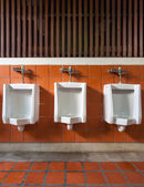 Three urinal in public toilet — Stock Photo