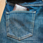 Blue jeans pocket with Wallet brown — Stock Photo