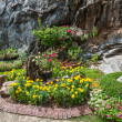 Colourful Flowerbeds and Winding Grass Pathway in an Attractive  — Photo